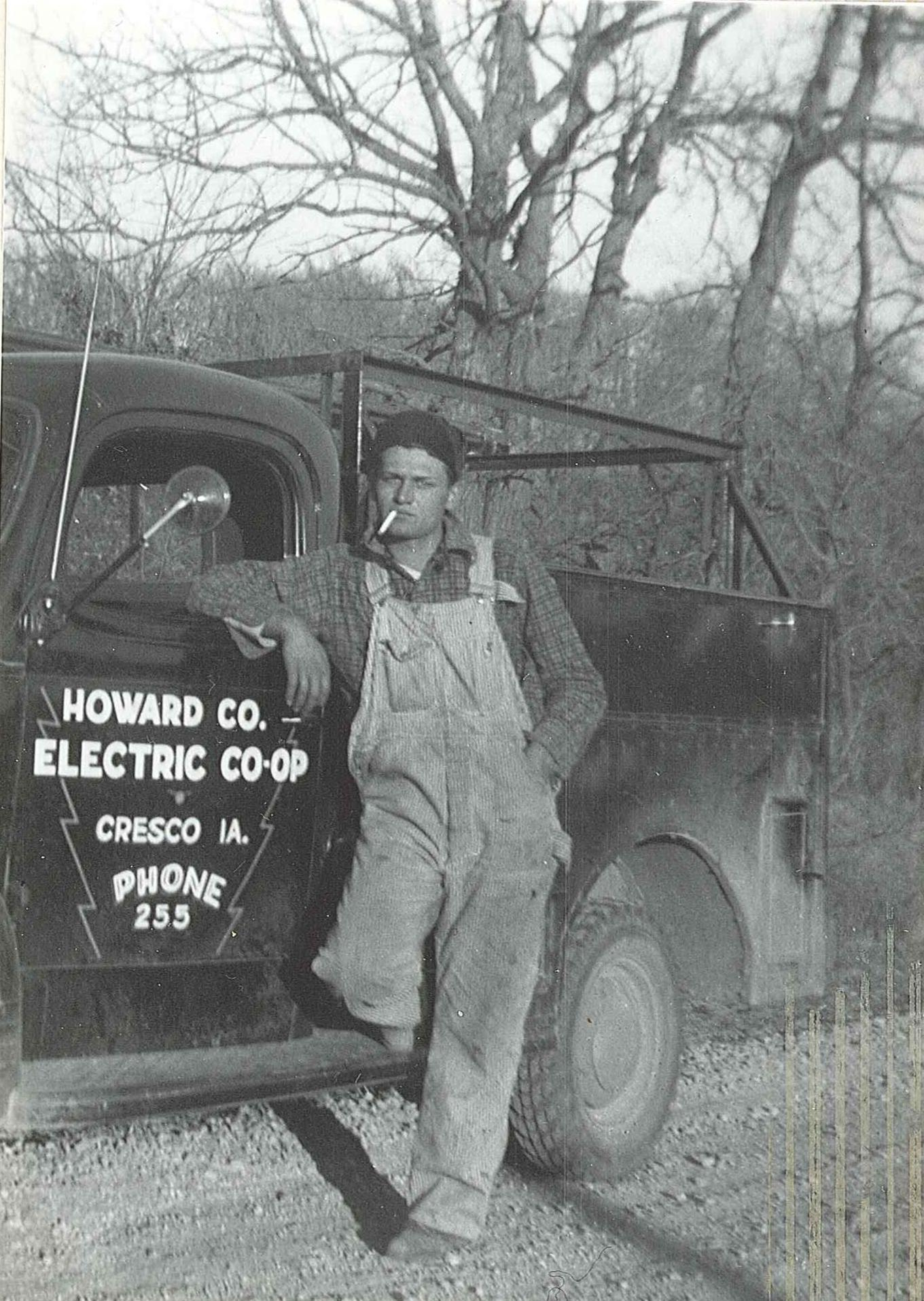 man in front of old truck in 1939