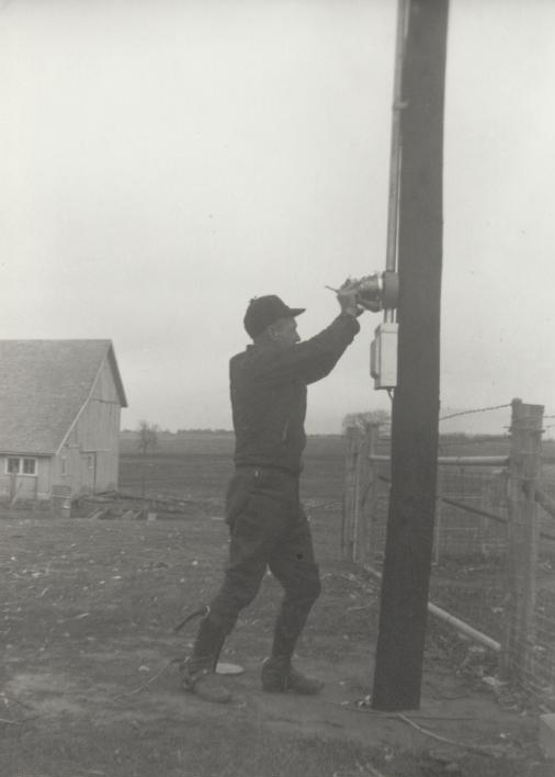 man installing meter on pole