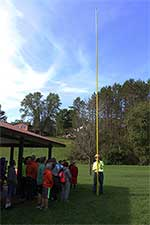 lineman demonstrating a hot stick
